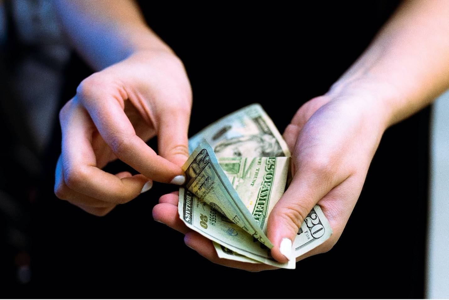 woman hands counting some dollar bills