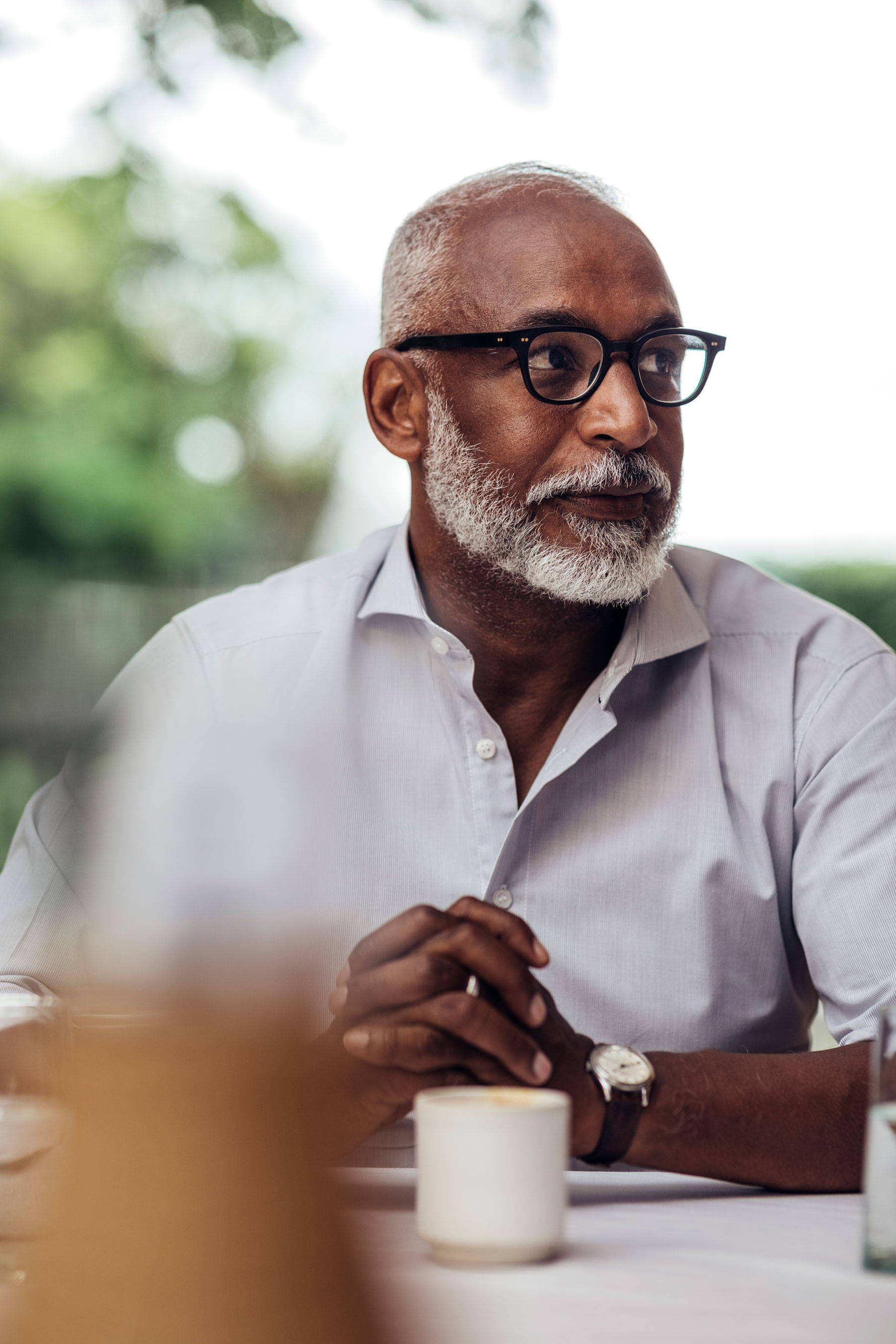 Man wearing glasses in casual shirt