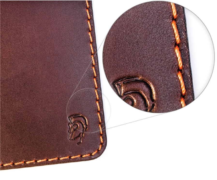 Hand stitching detail on vegetable tanned full grain leather.