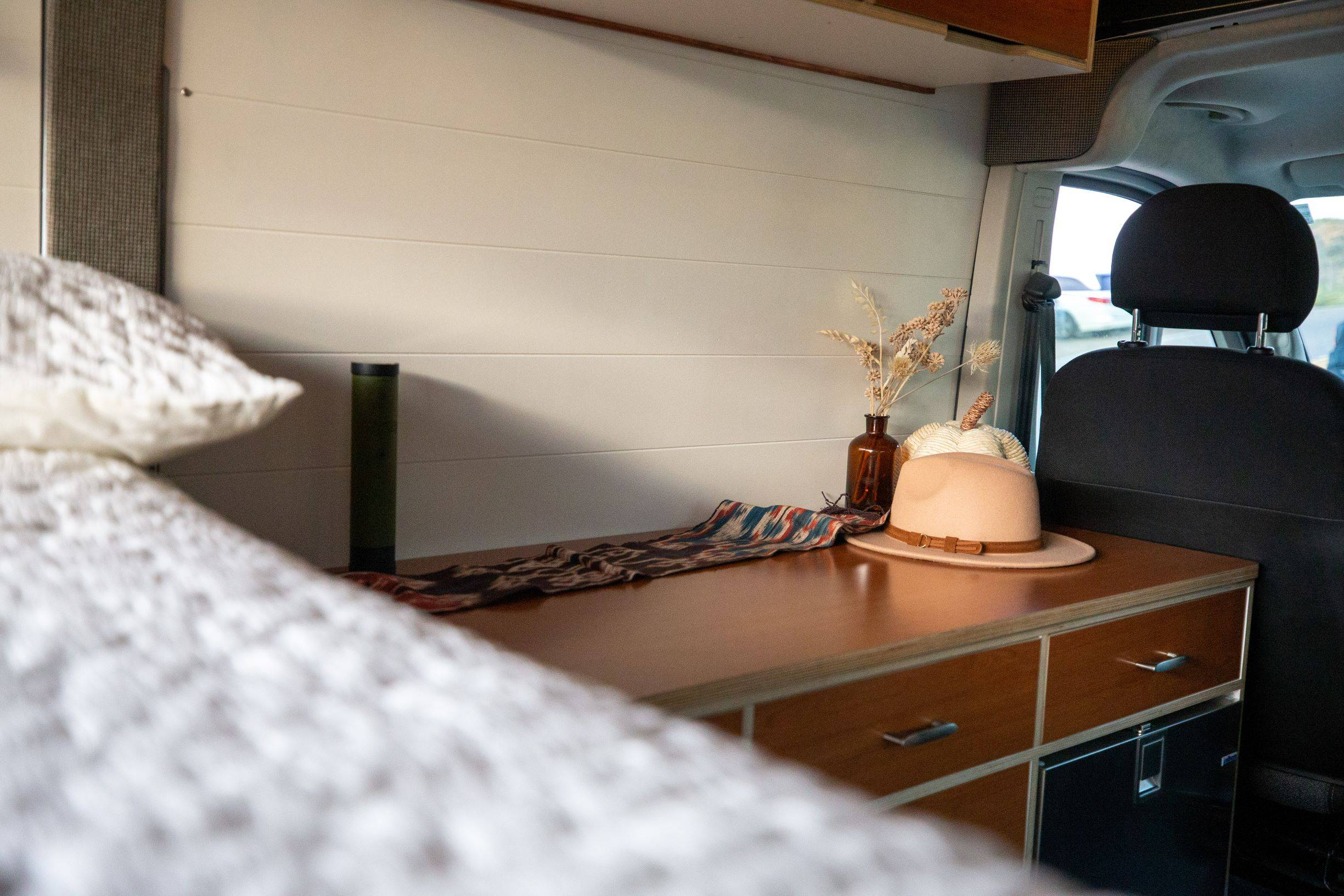 The Bivy - Sprinter 144 / ProMaster 136 Van Conversion - Galley / Interior Cabinets from Bed - The Vansmith