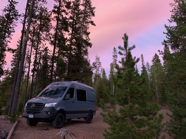 Mercedes 144 Sprinter van with Flarespace flares parked in the forest