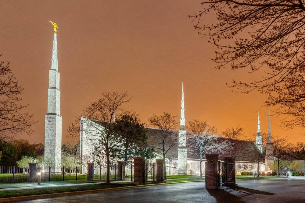 Chicago Illinois Temple glowing against an orange sky.