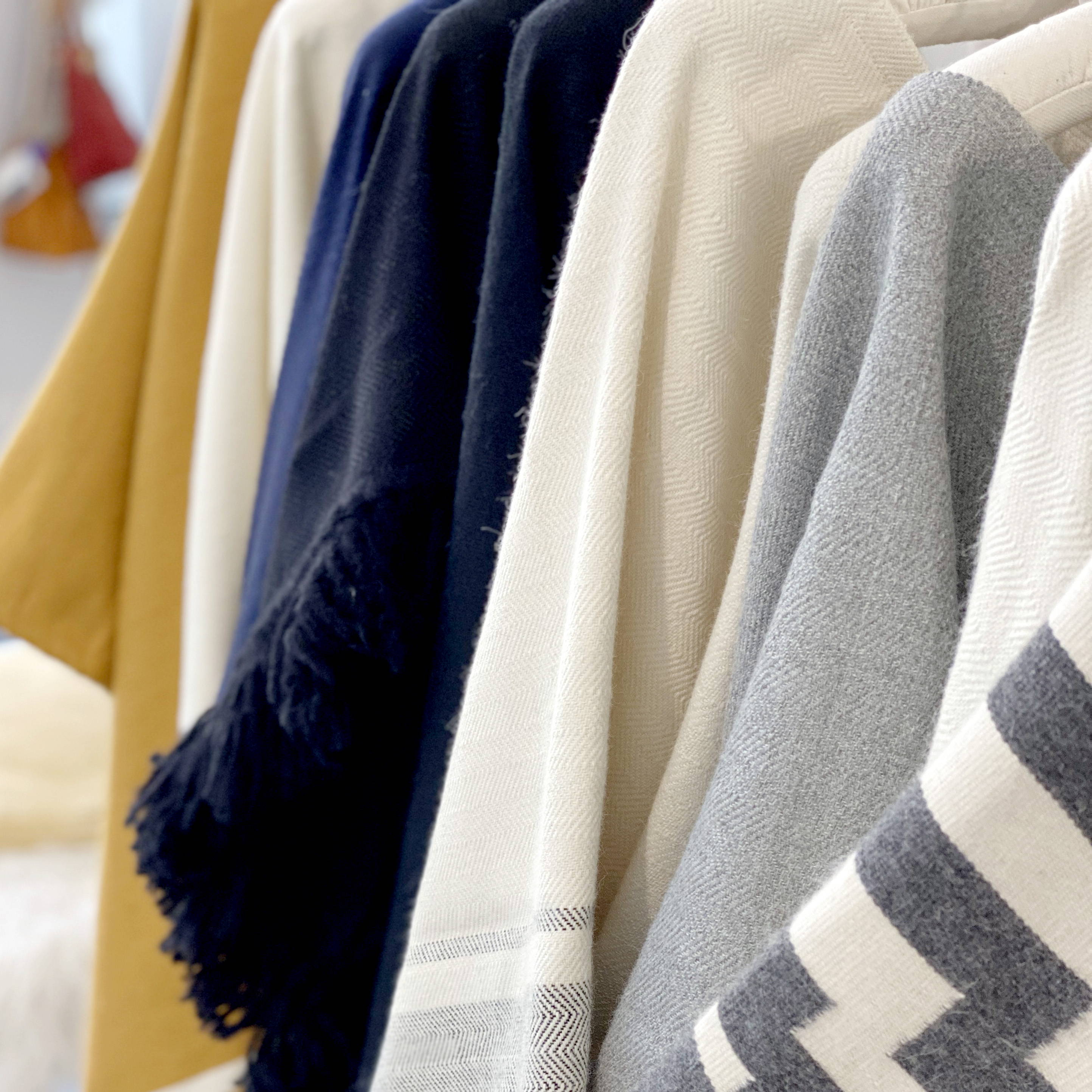 Display of handwoven Alpaca Ponchos from Stick & Ball