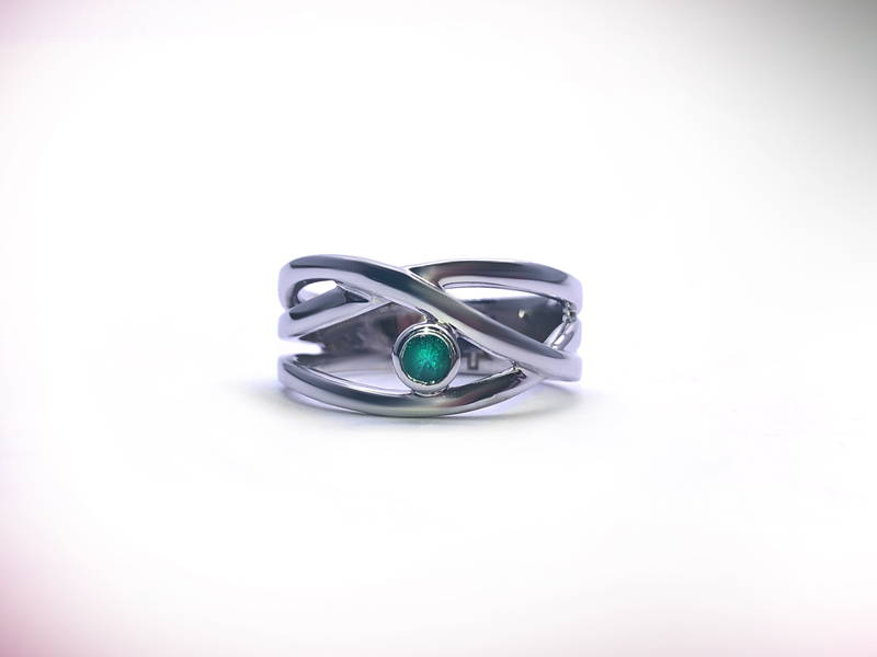 white gold cross ring with small emerald