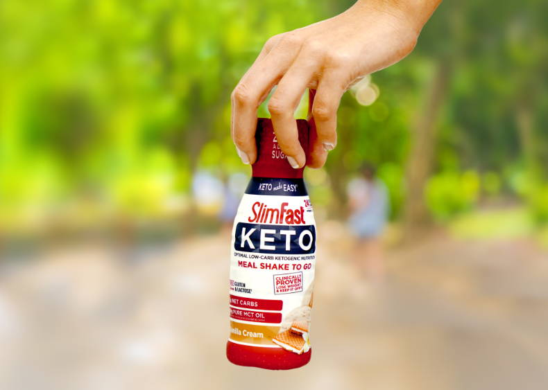 Keto Meal Shake to Go- lifestyle image of handing holding a bottle