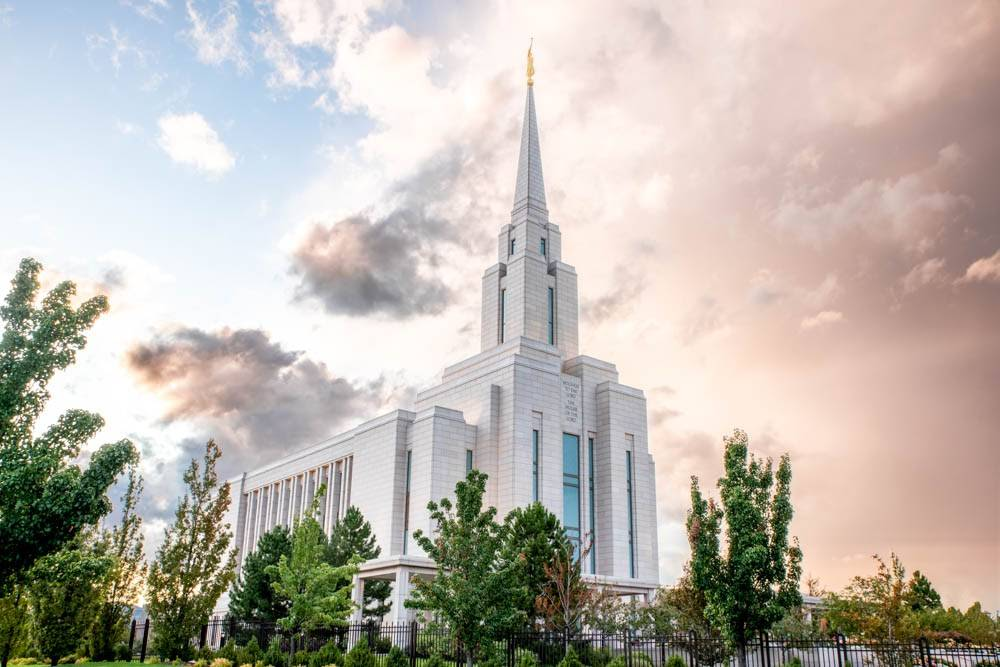 LDS art photo of Oquirrh Mountain Temple against a bright sky.