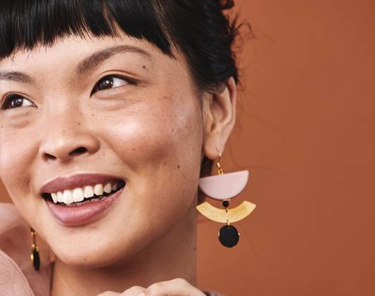 a women wears earrings