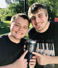 father and son holding custom logo tumbler engraved with logo past happy kodiak wholesale promotional products customer