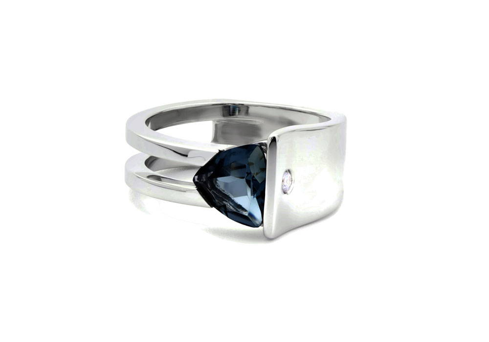 White gold architectural loook ring with trillion topaz stone london blue