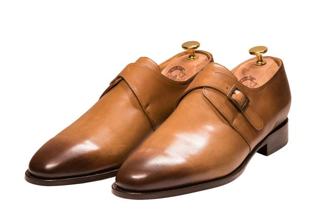 A pair of Mr. Dexter single monk strap shoes with wingtip and brogue detail.