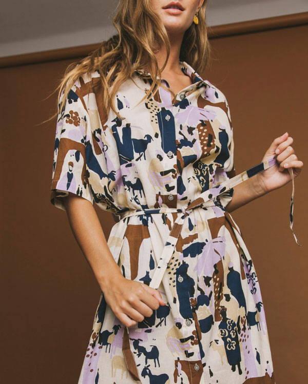 Close up of woman wearing pastel organic cotton belted shirt dress