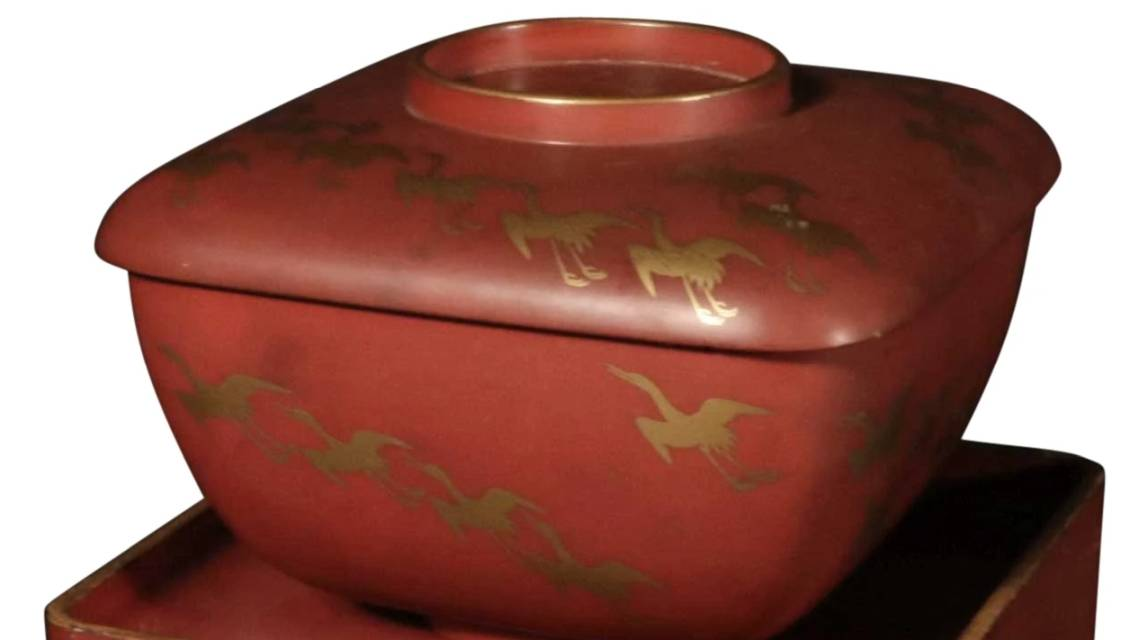Detail from a Meiji period red lacquer Japanese sake set
