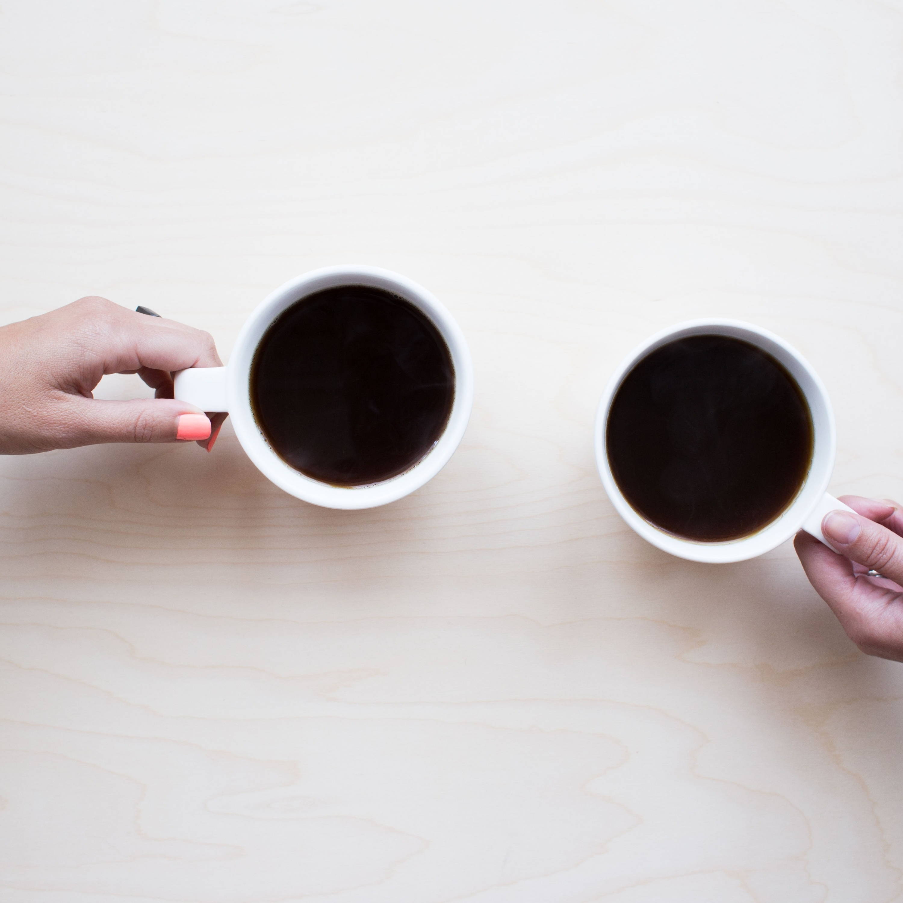 2 people drinking coffee