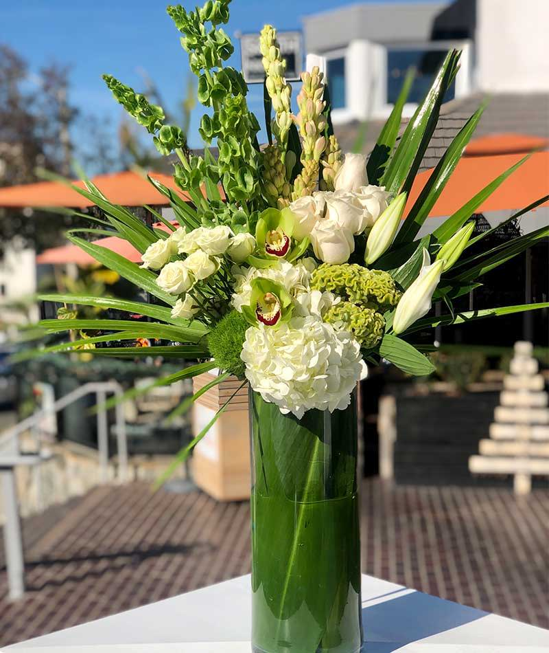 White and green bouquet of flowers placed outside