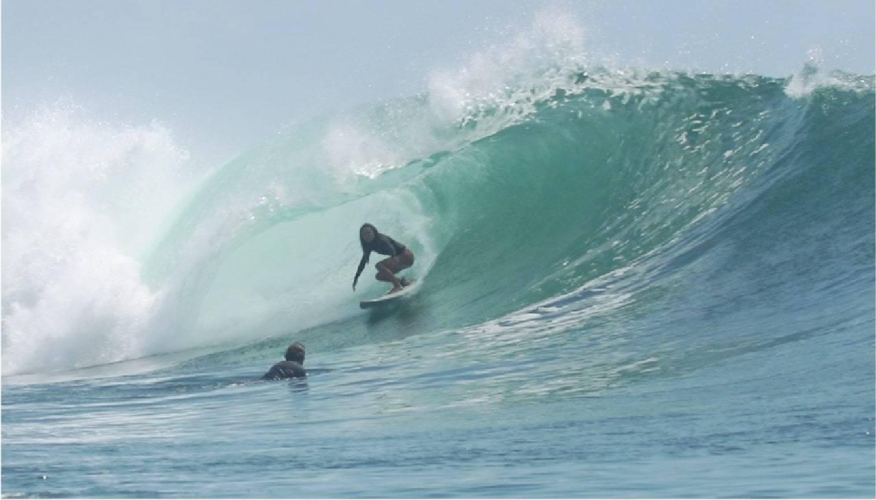 Delia Bense-Kang catching a wave!