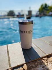 promotional product engraved custom logo tumbler by pool from happy customer testimonial working in real estate