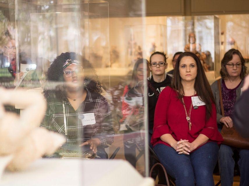 Educators sitting in a gallery