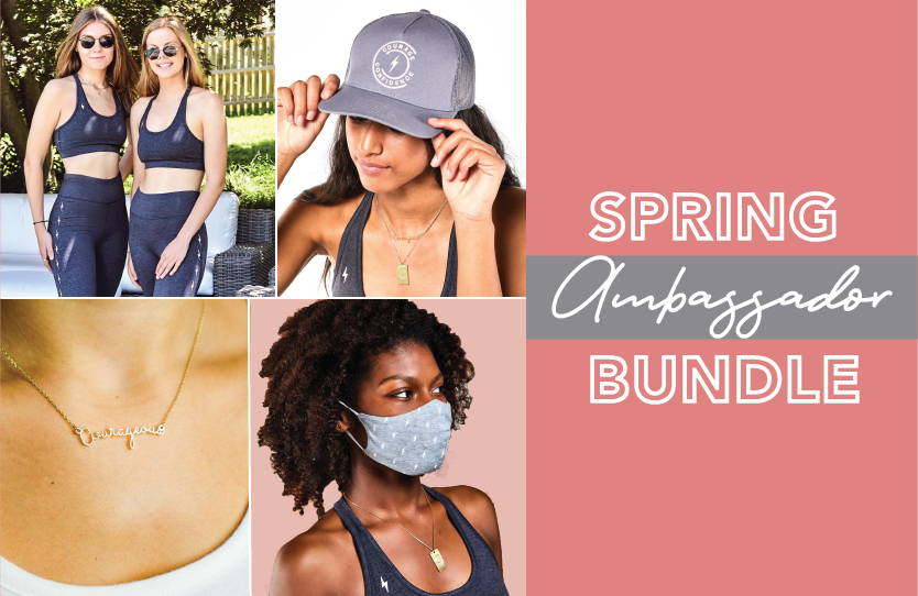 two girls is gray sports bra and gray leggings, gray and pink courage and confidence trucker hat, gold cursive Courageous necklace, gray mask with white lightening bolt print, spring ambassador Bundle