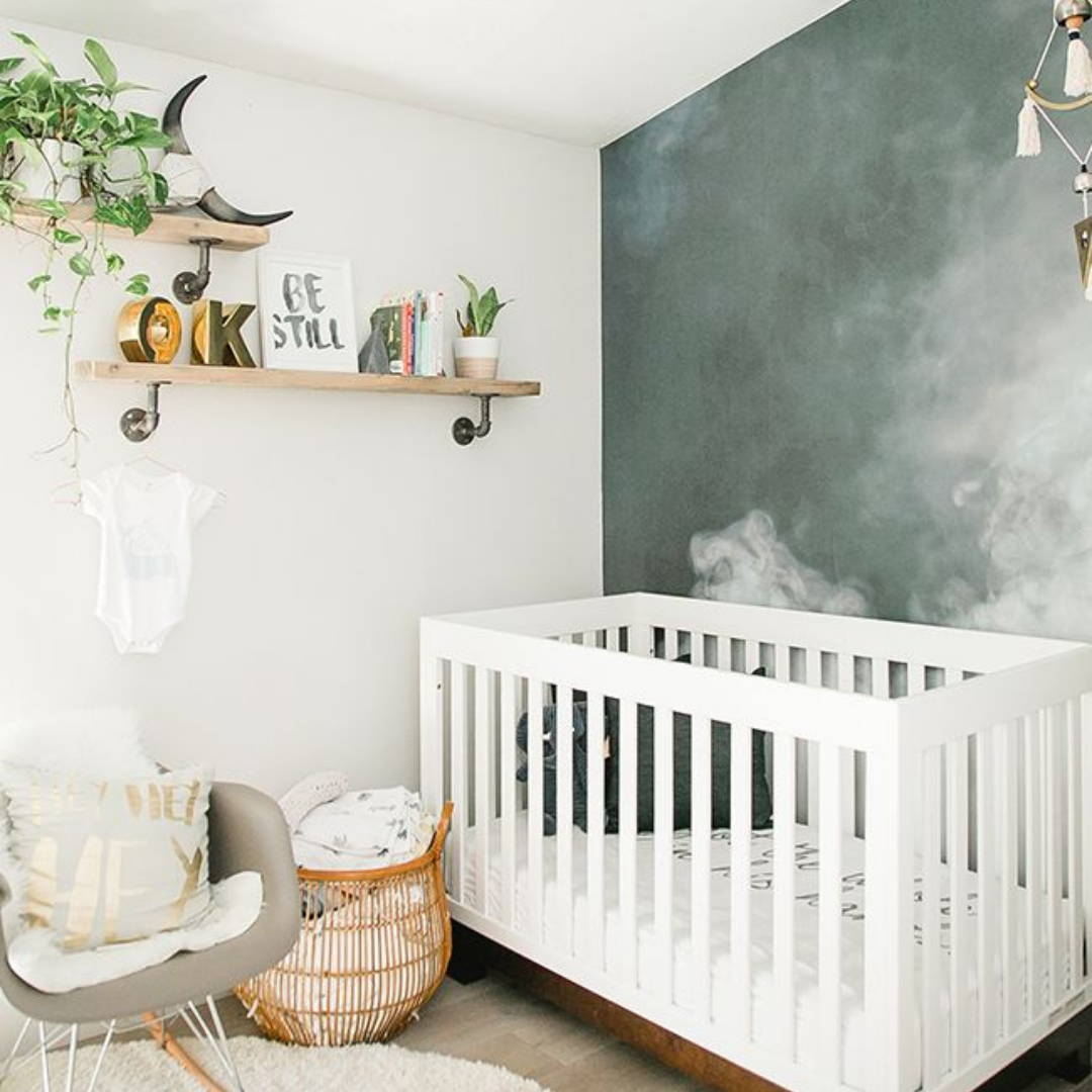 Contrast wall in neutral nursery decor with crib