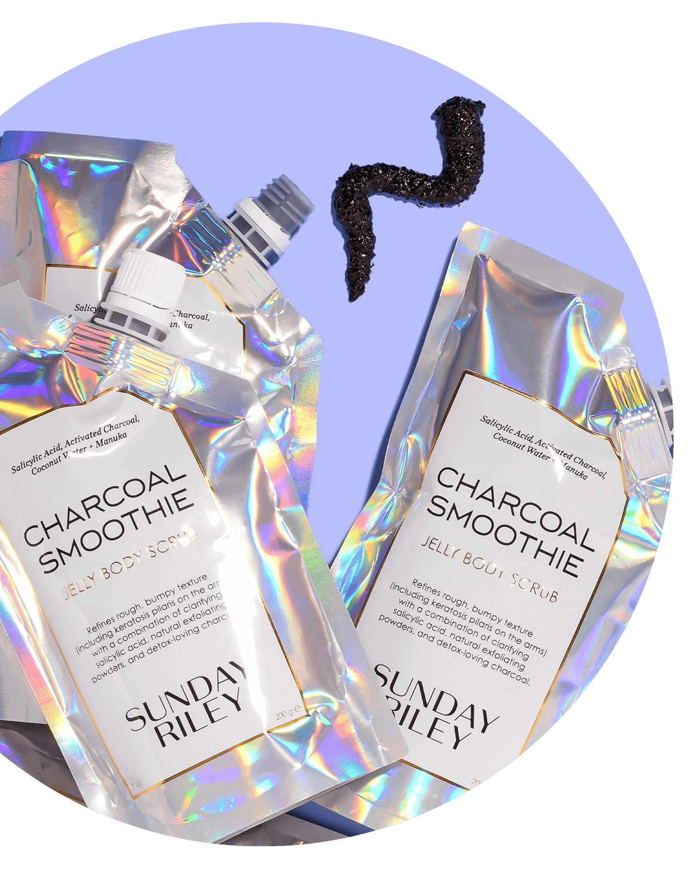 charcoal smoothie jelly body scrub packs with goop on purple background