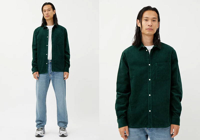 Man wearing men's green organic cotton cord shirt with blue organic cotton jeans and white t-shirt