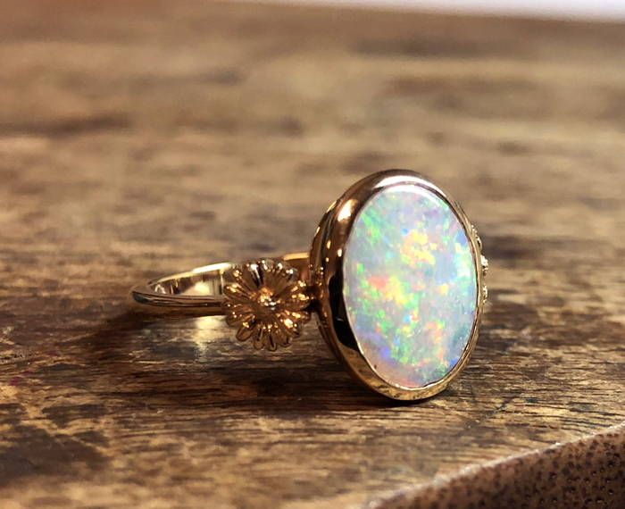 Opal on yellow gold flower ring