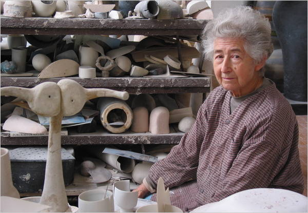 Ruth Duckworth with piles of ceramic art on shelves
