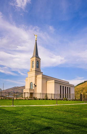 Vertical LDS art photograph of the Star Valley Wyoming temple against a blue sky.
