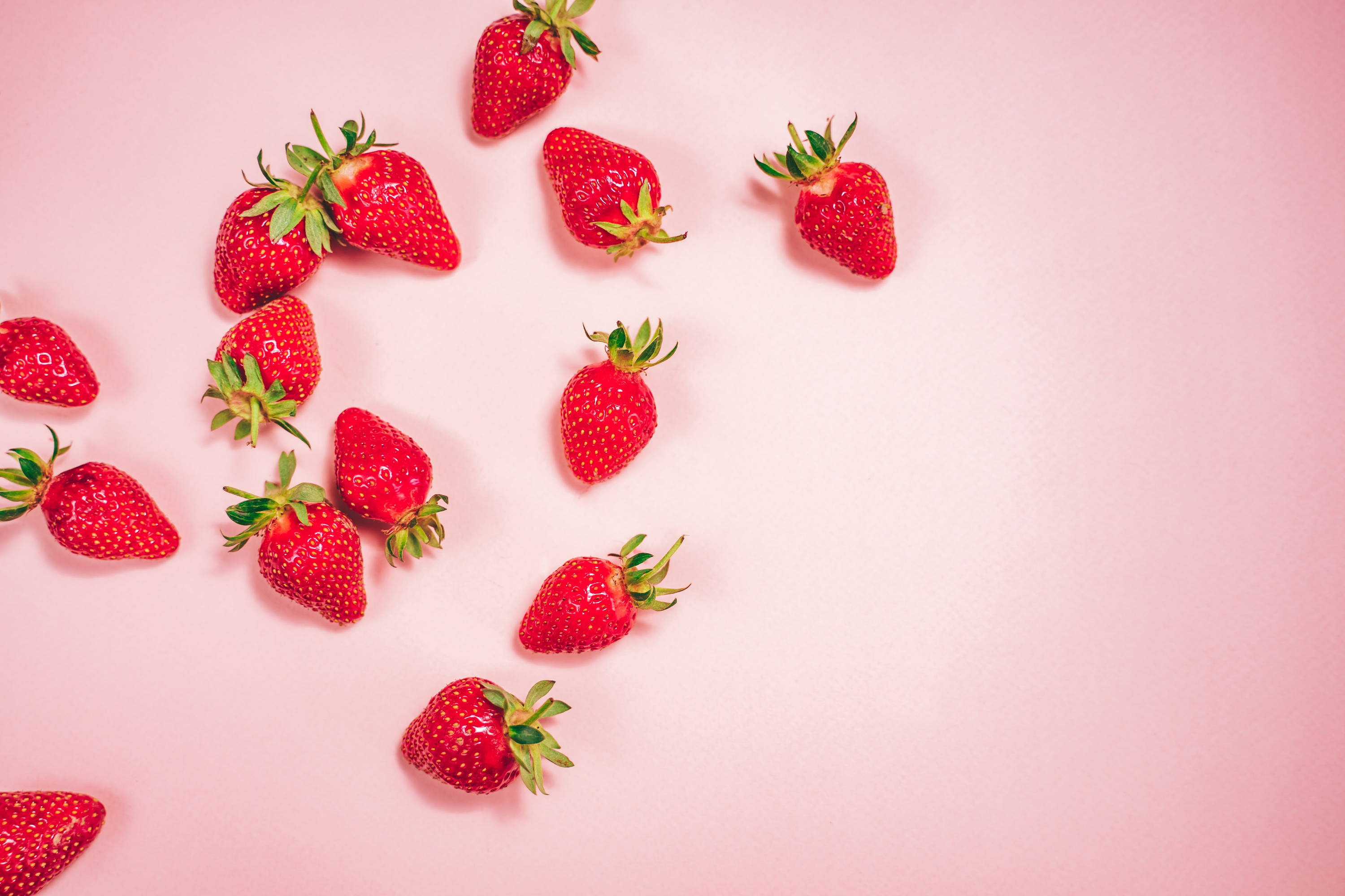 Strawberries on pink background