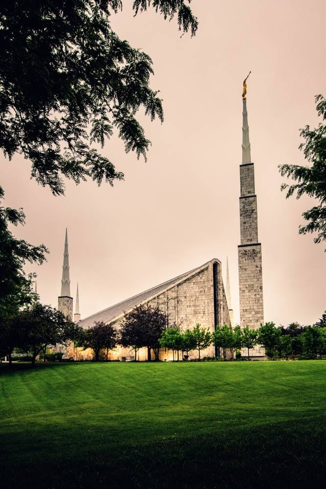 Side-angle photo of the Chicago Illinois Temple standing against a gray sky.