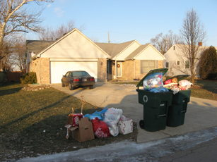 trash at curb overflowing