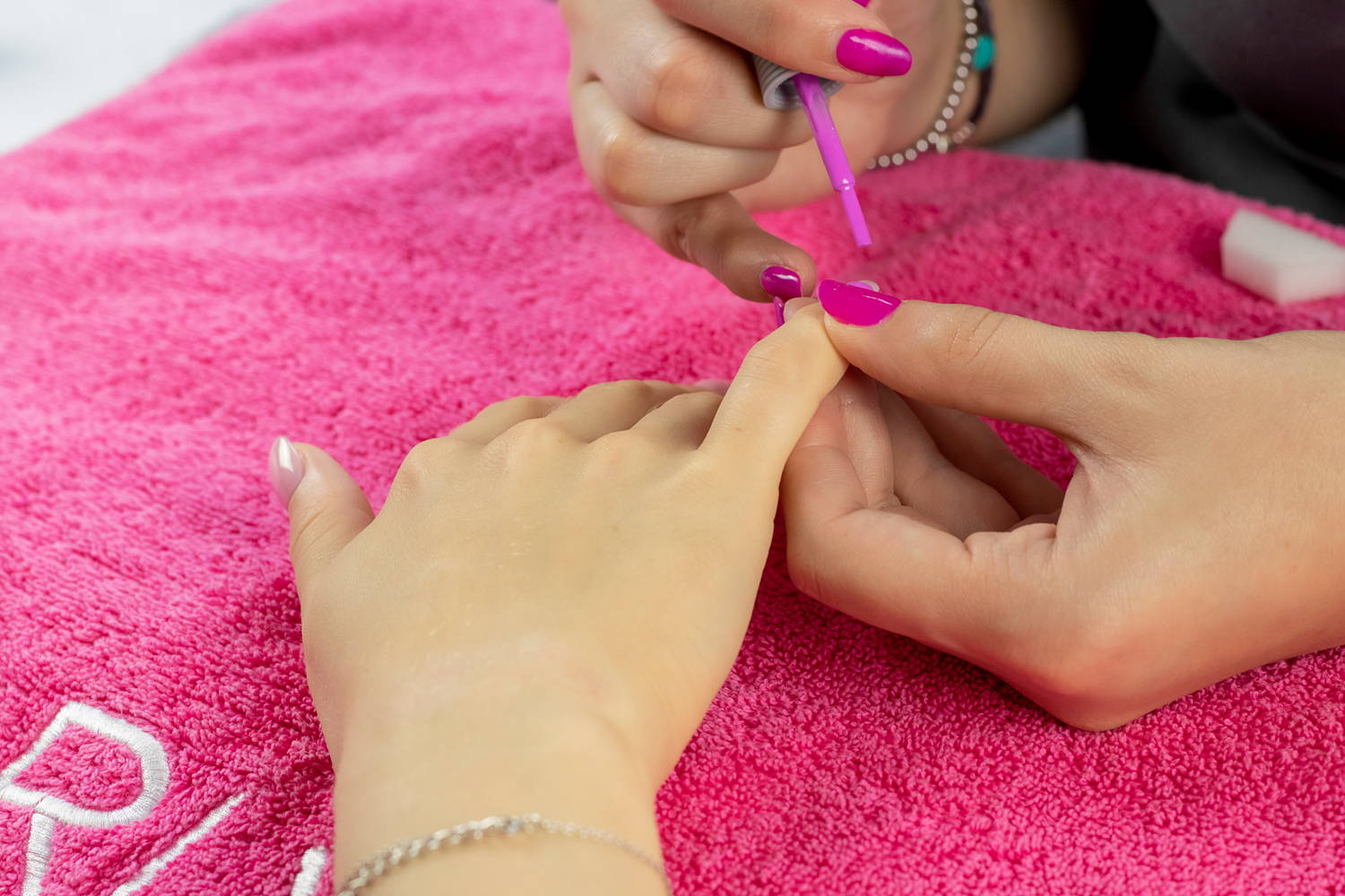 Nail art detail being painted using ORLY Scenic Route nail polish