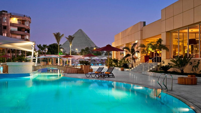 Pool area with view of Pyramids, Cairo, Egypt