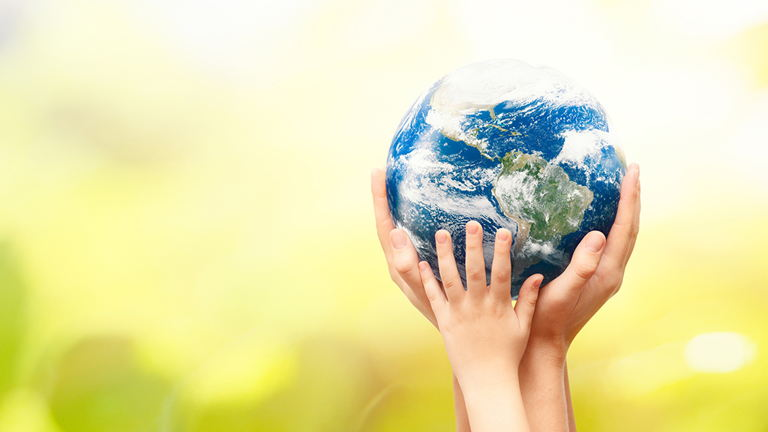 Earth Day globe in people's hands