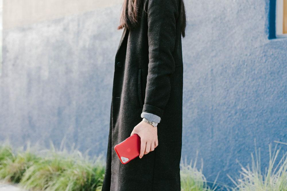 amberash_lifestyle_blackcoat-holdingphone-rouge.jpg