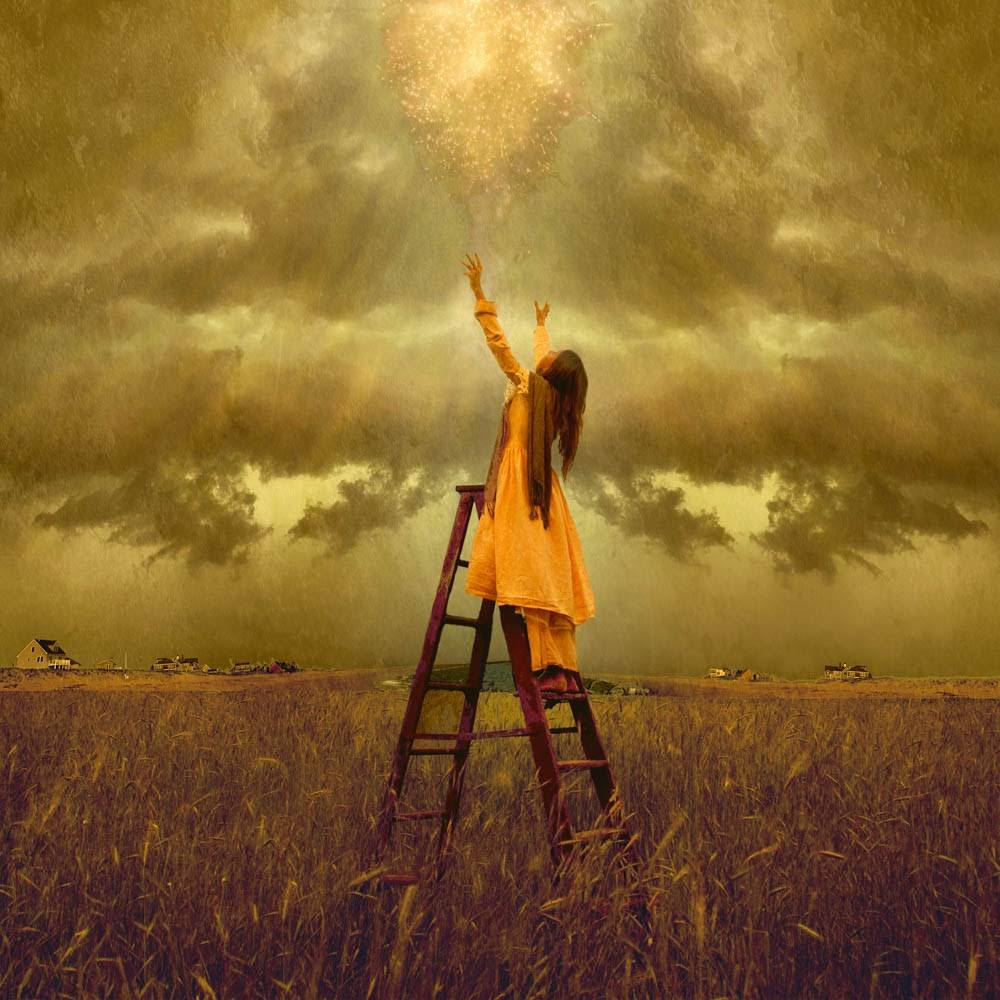 A young girl stands on a ladder in a field, reaching her arms toward Heaven. Gold glitter rains down toward her.