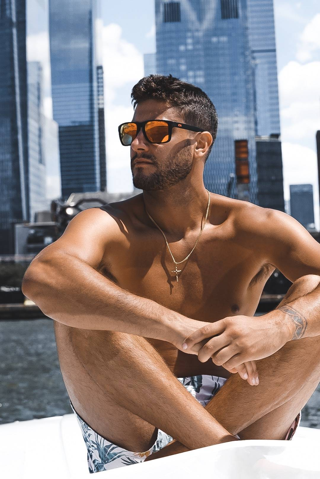 A boater relaxes in New York City with his stylish Rheos shades.