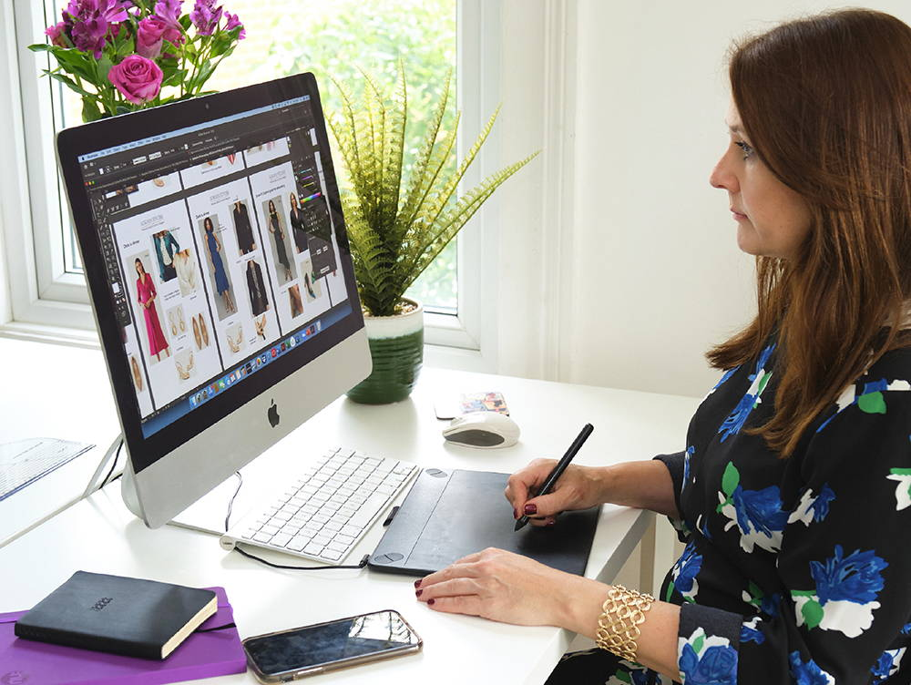 Stylist working on her computer to offer online styling sessions