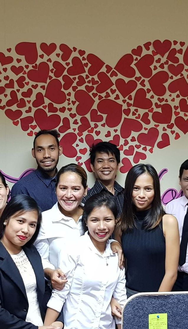 OBI Services About Us Group Pic with Heart Mobile View Image