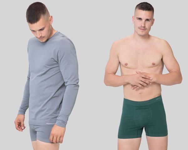 Man wearing grey long sleeve organic cotton t-shirt and man wearing organic cotton green boxers