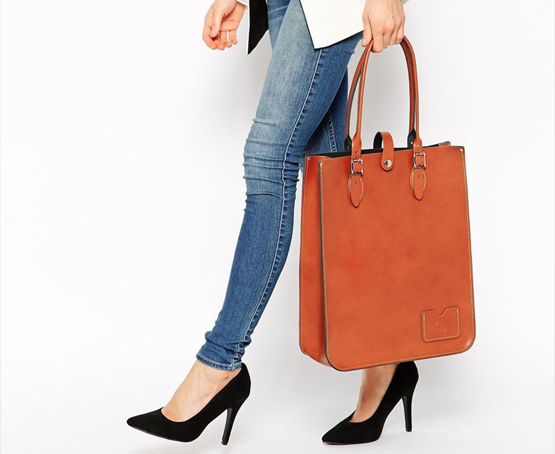 Model Holding a Leather Shopping Bag