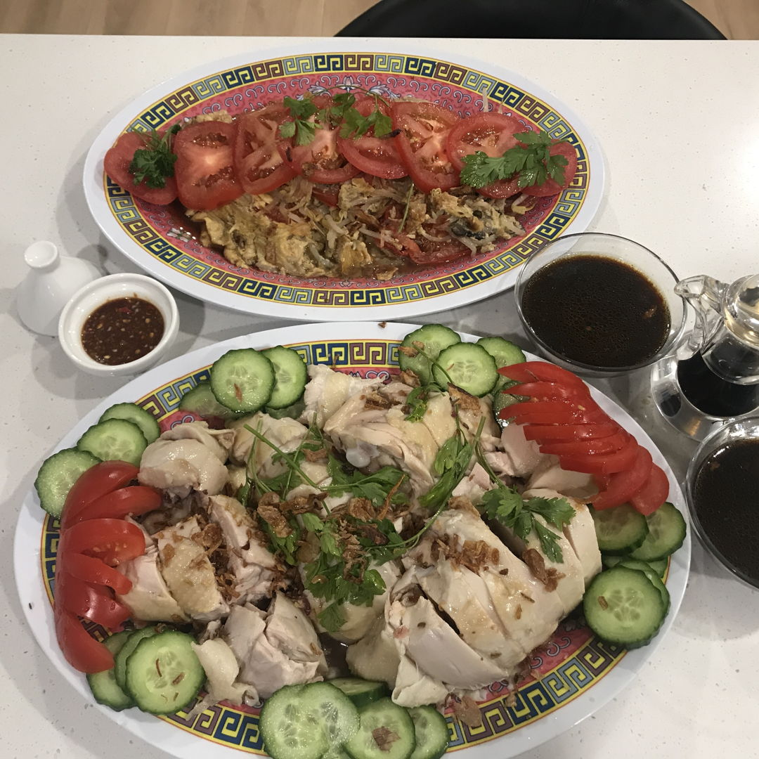 Front picture is Hainanese Chicken Rice cooked for dinner and the back dish was some omelette with mushroom and bean sprouts ... the chilli garam was good too... Enak selali