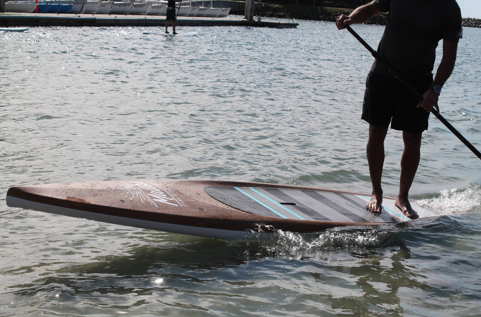 Malibu Tour 11 ft 6 board in wood wrap VFT close up photo with water splashing