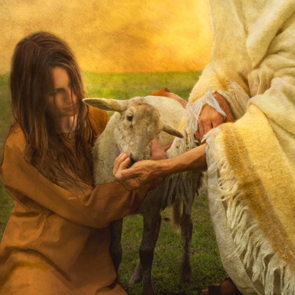 Image of a young woman holding a lamb while Jesus feeds it.