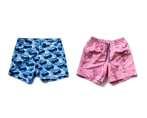 Blue mens patterned swimshorts and pink patterned mens boardshorts made sustainably from recycled fishing nets