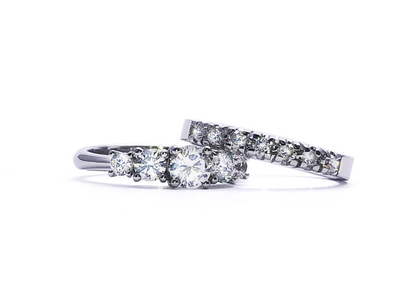 Two semi-eternity rings in white gold