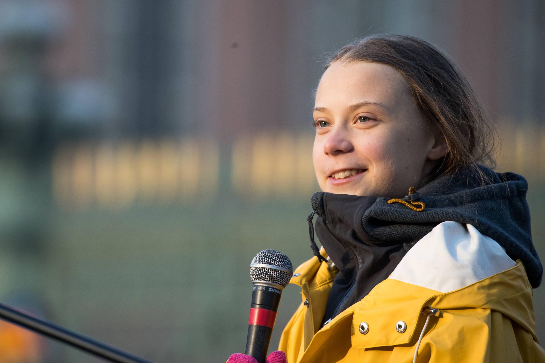 Greta Thunberg wearing a yellow mac