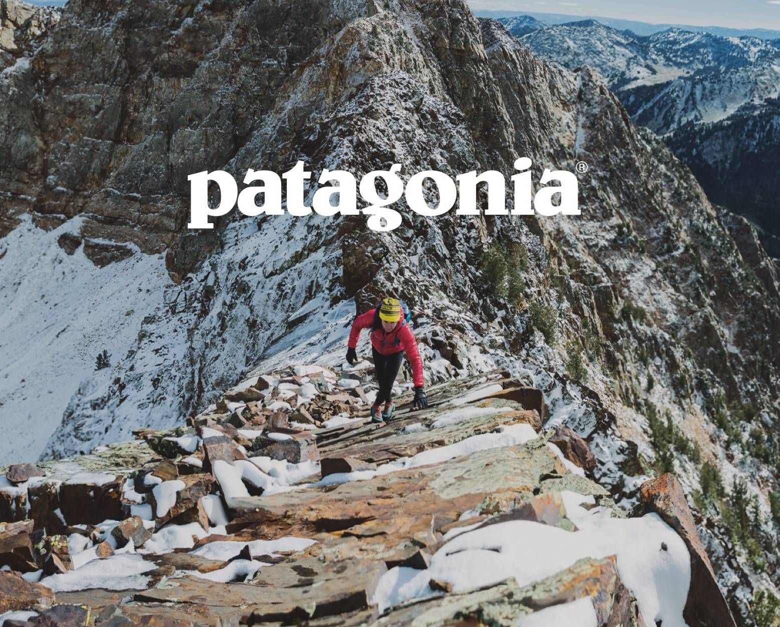 image of a woman climbing a snowy mountians, the word Patagonia