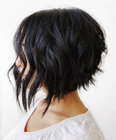 side view of a woman with a black short hairstyle