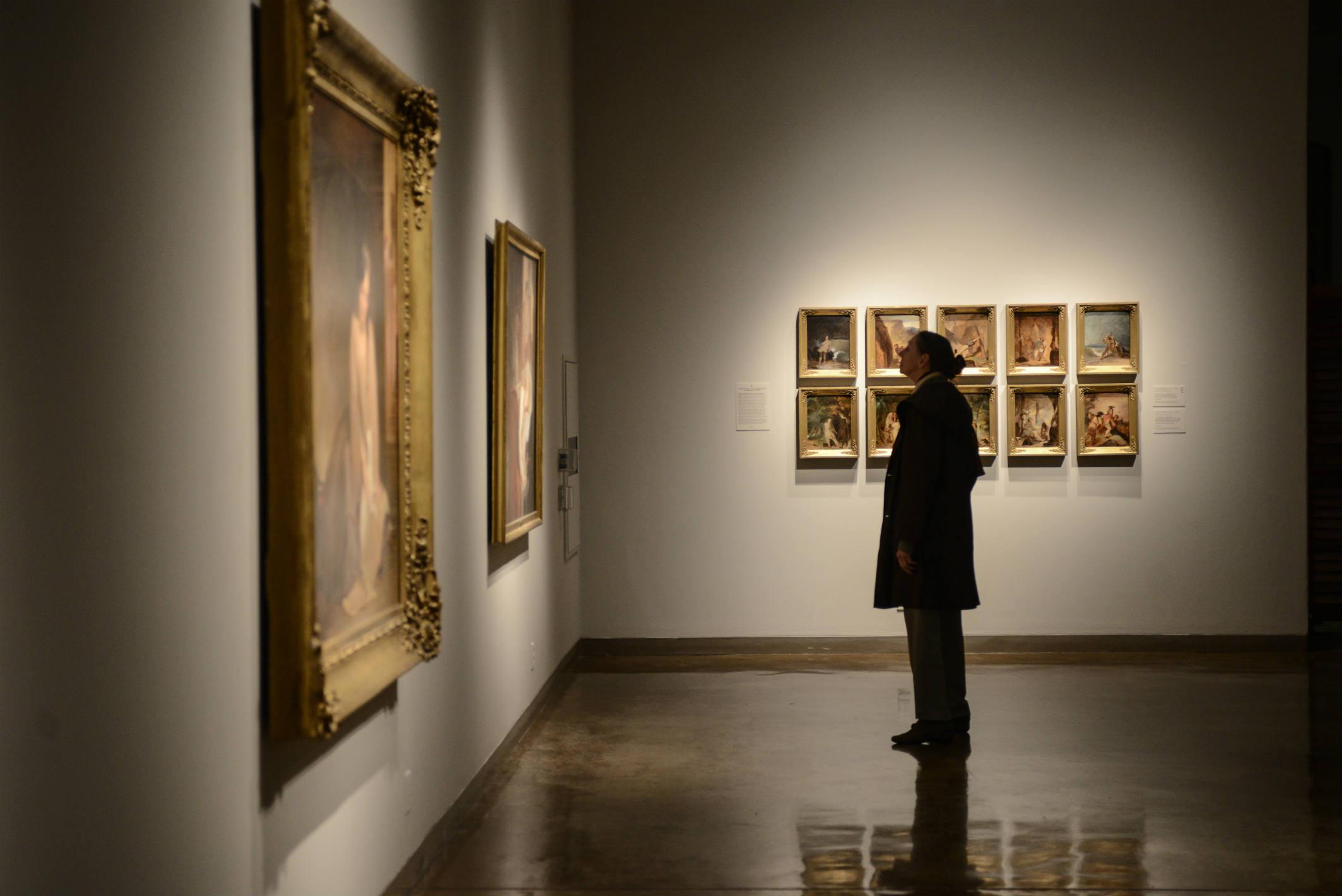 Woman looking at painting.